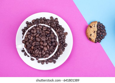 Coffee cup with chocolate cookies on a colorful background