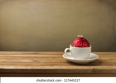 Coffee cup with Christmas decorations on wooden table