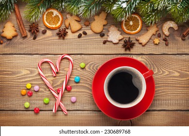 Coffee cup and christmas food decor on wooden table background