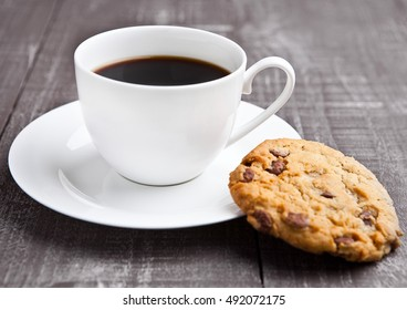 coffee cup with cookie for breakfast morning in cafe