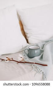 Coffee cup and cotton twig. Breakfast in bed. Cozy home.  flat lay, still life.