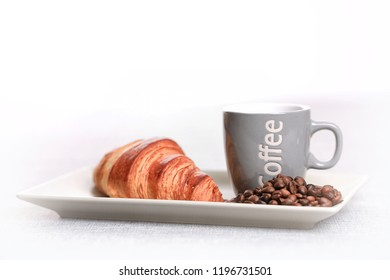 coffee cup and croissant