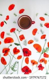 Coffee cup decorated wirh poppy flowers.
