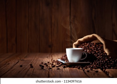 Coffee cup espresso with coffee beans and wooden background