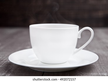 Coffee cup espresso  hot white on wooden board in cafe
