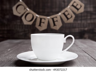 Coffee cup espresso  hot white on wooden board with letters
