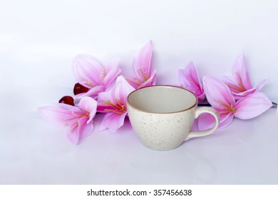 coffee cup and flower on white background