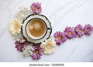 Coffee cup with flowers decoration