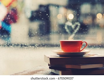 Coffee cup in front of mirror background,rainy day
