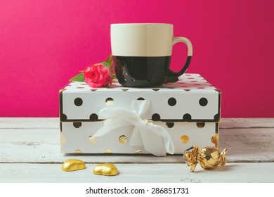 Coffee cup with glamour and elegant feminine objects and rose flower