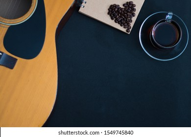Coffee cup with guitar On a black background