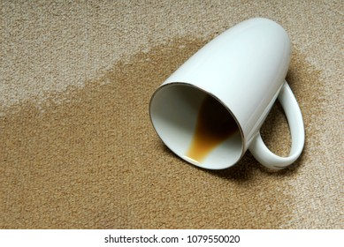 Coffee cup knocked over stains on carpet.