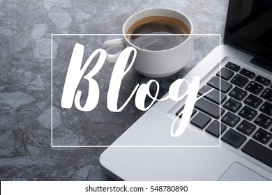 """Coffee cup with laptop computer with """"BLOG"""" Word ,Social Media Concept"""