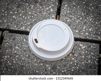 Coffee cup lid plastic waste close-up