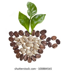 Coffee cup made of coffee beans and fresh leaves of coffee tree isolated on white