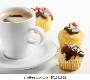 Coffee cup and muffins