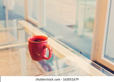 Coffee cup in the office on glass table