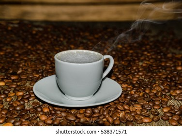 Coffee Cup on background of coffee.