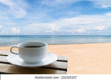 coffee cup on the beach background