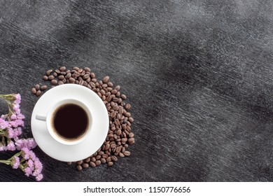 coffee cup on the black  wooden  background. And the space for your text.