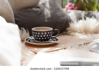Coffee cup on blanket bed