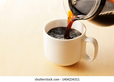 Coffee cup on bright background