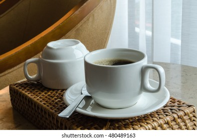 coffee cup, on brown wooden tray. (Select focus)