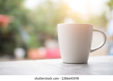 Coffee cup on desk and Morning sunlight