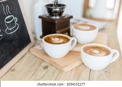 coffee cup on old wood table,coffee lover background concept,selective focus on single coffee cup.
