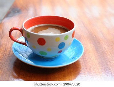 Coffee cup on old wooden