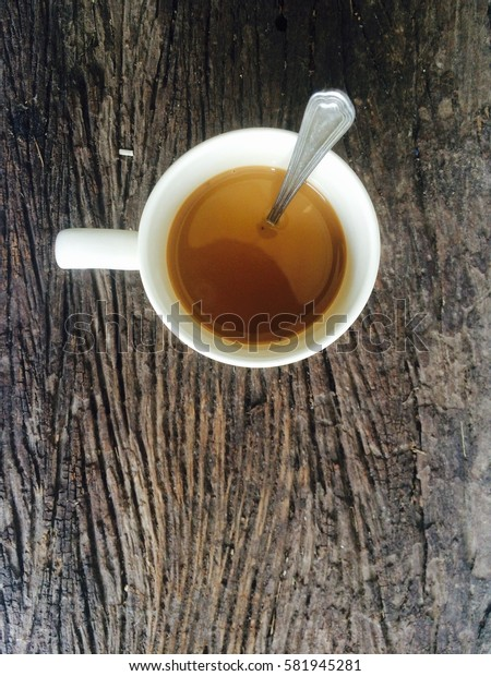 Coffee cup on old wooden floor