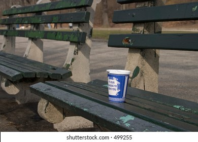 coffee cup on park bench