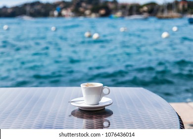 Coffee cup on a table against the background of the sea