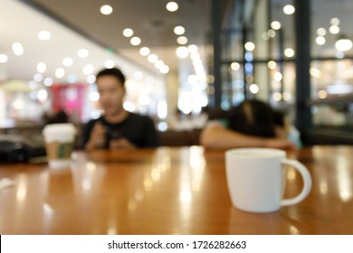 coffee cup on table inside cafe, image abstract blurred background