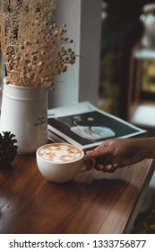 coffee cup on table.hand holding coffee cup.