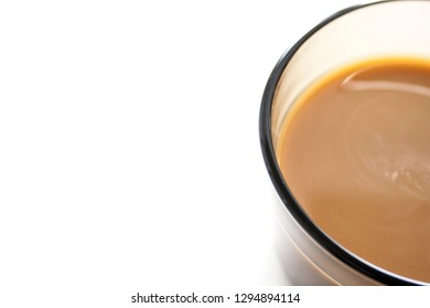 Coffee cup on white background. Coffee still life. Only a half cup of coffee on white.