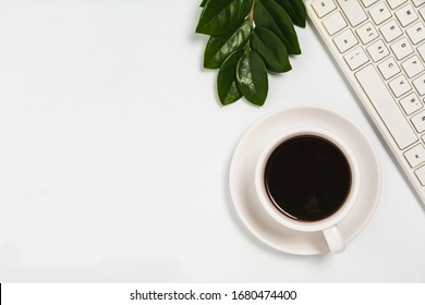 A coffee cup on white office desk with copy space. Business and workspace concept.