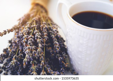Coffee cup on white table. Good morning. Tasty coffee. Cappuccino. Caffeine. Love for coffee. Lavender. Aroma of lavender. Aroma of coffee. cafe.