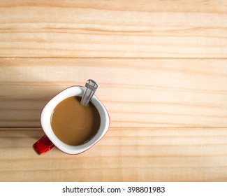Coffee cup on a wood background., Flat lay.