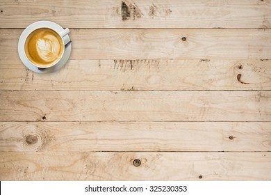 coffee cup on wood table with space