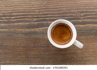 coffee in a cup on a wooden background