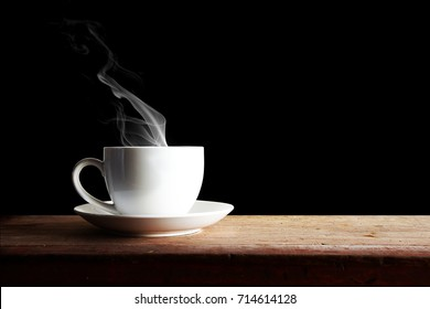 coffee cup On wooden a dark black  background