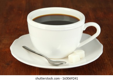 Coffee cup on wooden table close-up