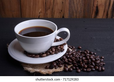 Coffee cup on wooden table and space for texture.