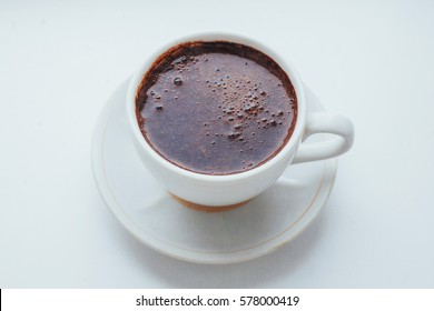 coffee cup over white background. The morning celebration.