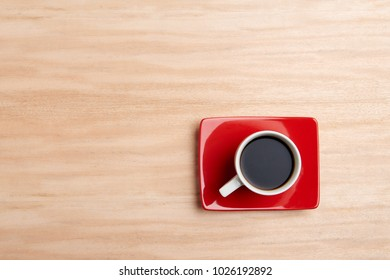 coffee cup over wooden background