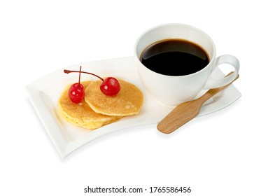 coffee cup with pancakes and cherry isolated on white background ,include clipping path