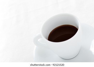 Coffee Cup with Plate on White Background, High Key