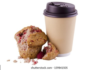 Coffee cup and raspberry muffin on white background.