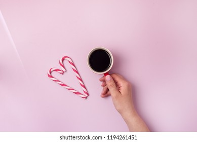 Coffee Cup Red Cofffee Capsules Candy Canes Pink Background Cookies Christmas background Top view Flat Lay